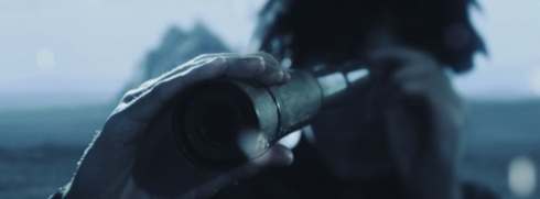 Grimsley using a spyglass.